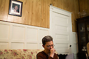 March 12, 2009. Rocky Mount, NC.<br />  June details the ordeal in the living room of the home she and Pam shared. A photo of Pam in on the wall.<br />  Juneann Tesarz Galbraith lost her partner, Pam, in January 2009. Due to the fact that they could not be legally married or considered civil partners under NC law, June has had to deal with the ordeal much on her own.. June is also currently unemployed and was living off the disability payments that Pam received while still alive. She is in danger of losing her home if she does not find a job soon, but living in a town with an estimated 12% her chances are diminished..