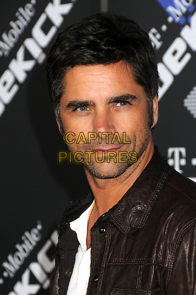 JOHN STAMOS.The T-Mobile Sidekick 4G Launch Party held at a private lot in Beverly Hills, California, USA..April 20th 2011.headshot portrait brown black leather stubble facial hair .CAP/ADM/BP.©Byron Purvis/AdMedia/Capital Pictures.