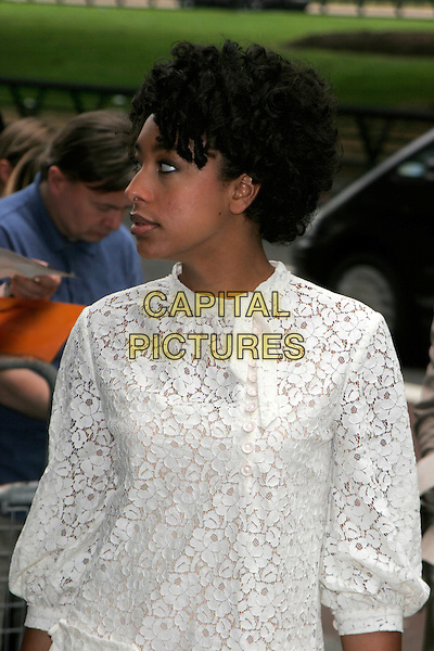 CORINNE BAILEY RAE.Arrivals at the Ivor Novello Awards, Grosvenor House, London, England..May 24th, 2007.half length white dress lace profile.CAP/AH.©Adam Houghton/Capital Pictures
