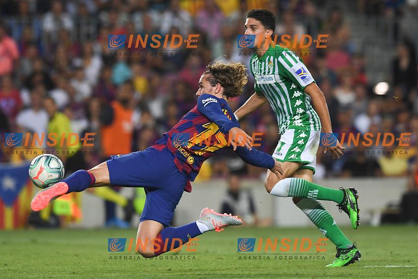 FOOTBALL: FC Barcelone vs Real Betis - La Liga-25/08/2019<br /> Antoine Griezmann (FCB), Bartra (Betis) <br /> 25/08/2019 <br /> Barcelona - Real Betis  <br /> Calcio La Liga 2019/2020  <br /> Photo Paco Largo/Panoramic/insidefoto