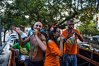"RIO DE JANEIRO, BRAZIL - FEBRUARY 23, 2014: (Left)Roni Valk, a carer, (Centre)Polyanna Ferrari and (Right)André da Silva Lisboa, 38, better known by his nickname, André Poetry, a samba singer and a janitor at a McDonald's, who has been diagnosed with schizophrenia, sing atop of the float during the annual Tá Pirando, Pirado, Pirou! carnival street parade on February 23, 2014 in Rio De Janeiro, Brazil. It looks like any of the other 450 or so street parties, locally called ""carnival blocks,"" that parade through Rio de Janeiro during the raucous pre-Lenten festivities that draw hundreds of thousands to the city each year. What makes this party different are its performers and organizers: psychiatric patients and their doctors, therapists, family members, neighbors and passers-by. The group, called Tá Pirando, Pirado, Pirou!, which roughly translates as ""We're freaking out, we already freaked out!"", began ten years ago when Brazil was in the process of dismantling its century-old system of mental asylums. A law passed in 2001 called for long-term outpatient psychiatric care to be offered primarily in community clinics. The number of such clinics increased more than fivefold in the following decade, while the number of asylum beds for psychiatric patients dropped 40 percent nationwide.<br /> <br /> Daniel Berehulak for The New York Times"