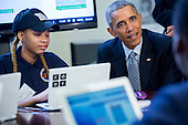 """United States President Barack Obama talks to middle-school students including Adrianna Mitchell who are participating in an """"Hour of Code"""" event in the Eisenhower Executive Office Building next to the White House in Washington, D.C., U.S., on Monday, December 8, 2014. The event is in honor of Computer Science Education Week. <br /> Credit: Andrew Harrer / Pool via CNP"""