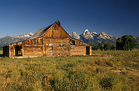 Grand Teton National Park, Jackson Hole, WY, Wyoming, Old wooden barn at Antelope Flats with a view of the Grand Teton Mountains in the background in Grand Teton Nat'l Park in Wyoming.