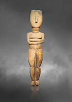Female Cycladic Canonical type, Spedos variety female figurine statuette. Early Cycladic Period II from Syros phase (2800-2300 BC). Museum of Cycladic Art Athens, cat no 282.  Against Grey Background.