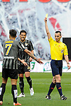 Malaga CF´s Samuel Garcia Sanchez receives a yellow card from the referee Santiago Jaime Latre during 2014-15 La Liga match between Rayo Vallecano and Malaga CF at Rayo Vallecano stadium in Madrid, Spain. March 21, 2015. (ALTERPHOTOS/Luis Fernandez)