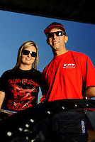 Sept. 5, 2010; Clermont, IN, USA; NHRA pro stock driver Erica Enders (left) with boyfriend Richie Stevens Jr during qualifying for the U.S. Nationals at O'Reilly Raceway Park at Indianapolis. Mandatory Credit: Mark J. Rebilas-