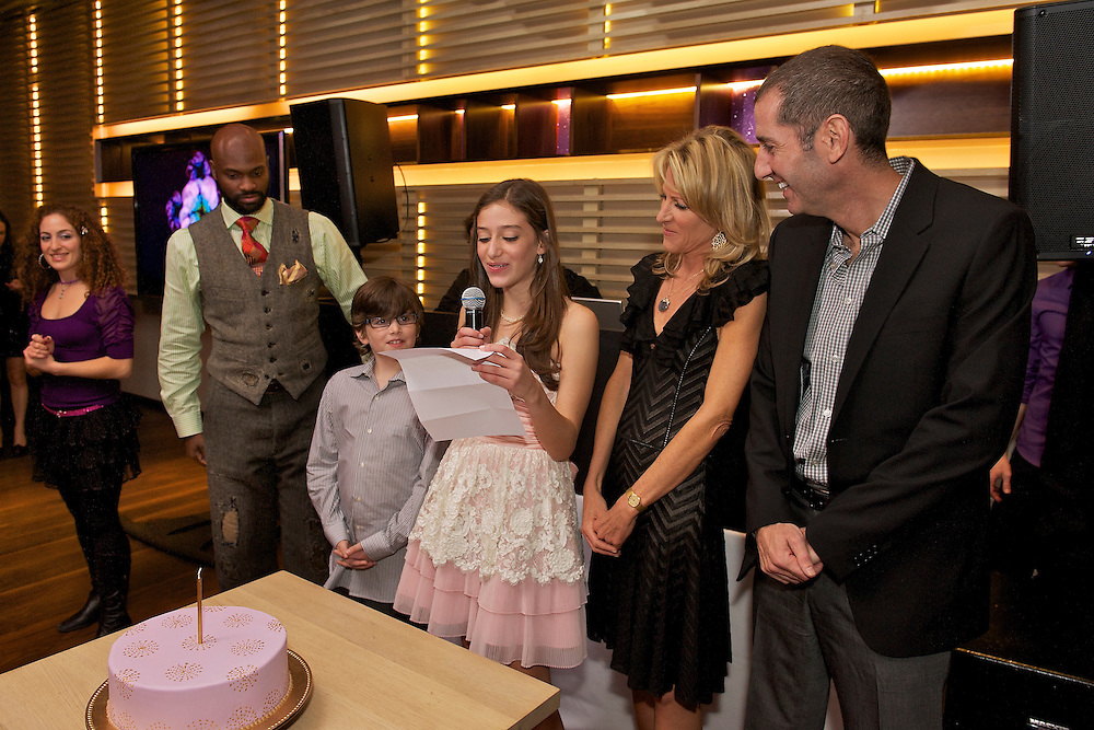 The Bat Mitzvah girl with her family making a toast.