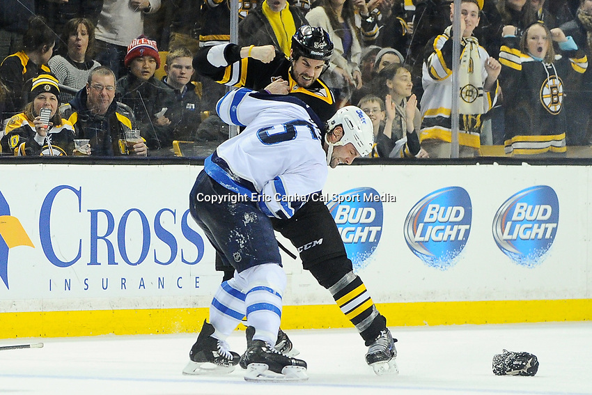 January 2, 2014 - Boston, Massachusetts, U.S. - Boston Bruins defenseman Adam McQuaid (54) and Winnipeg Jets defenseman Mark Stuart (5) fight  during the NHL game between Winnipeg Jets and the Boston Bruins held at TD Garden in Boston Massachusetts.  Boston defeated Winnipeg 4-1 in regulation. Eric Canha/CSM
