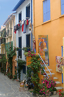 Collioure, with its long narrow alleys, was a favorite haunt of artist Henri Matisse. I was fortunate to catch the woman hanging laundry.