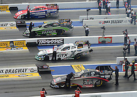 Apr. 15, 2012; Concord, NC, USA: NHRA funny car drivers (from top) Johnny Gray , Alexis DeJoria , Mike Neff and Blake Alexander race during eliminations for the Four Wide Nationals at zMax Dragway. Mandatory Credit: Mark J. Rebilas-