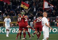 Calcio, Serie A: Lazio-Roma. Roma, stadio Olimpico, 18 aprile 2010..Football, Italian serie A: Lazio-Roma. Rome, Olympic stadium, 18 aprile 2010. AS Roma players, at center, in red, celebrate at the end of the match. AS Roma won 2-1..UPDATE IMAGES PRESS/Riccardo De Luca