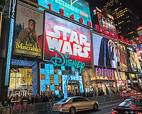 Advertising for J.J. Abrams' Star Wars: The Force Awakens, which will premiere in two weeks, on a giant LED screen above the Disney Store in Times Square in New York on Tuesday, December 15, 2015. With the release of numerous trailers, licensed merchandise and now in-your-face advertising the Disney Co. promotional juggernaut has amped up for the blockbuster release.(© Richard B. Levine)