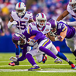 19 October 2014: Minnesota Vikings quarterback Teddy Bridgewater is tackled by Buffalo Bills strong safety Duke Williams (27) on a keeper play in the fourth quarter at Ralph Wilson Stadium in Orchard Park, NY. The Bills defeated the Vikings 17-16 in a dramatic, last minute, comeback touchdown drive. Mandatory Credit: Ed Wolfstein Photo *** RAW (NEF) Image File Available ***