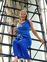 Theatre performer on the rigging of the tall ship Christian Radich at the Midsummer opening show in 2012