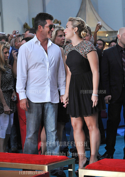"Demi Lovato & Simon Cowell at the season two premiere of ""X Factor USA"". They and the other judges had their handprints set in cement at Grauman's Chinese Theatre, Hollywood..September 11, 2012  Los Angeles, CA.Picture: Paul Smith / Featureflash"