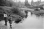 Upper Slaughter, Gloucestershire 1975. England. River Eye running through village.