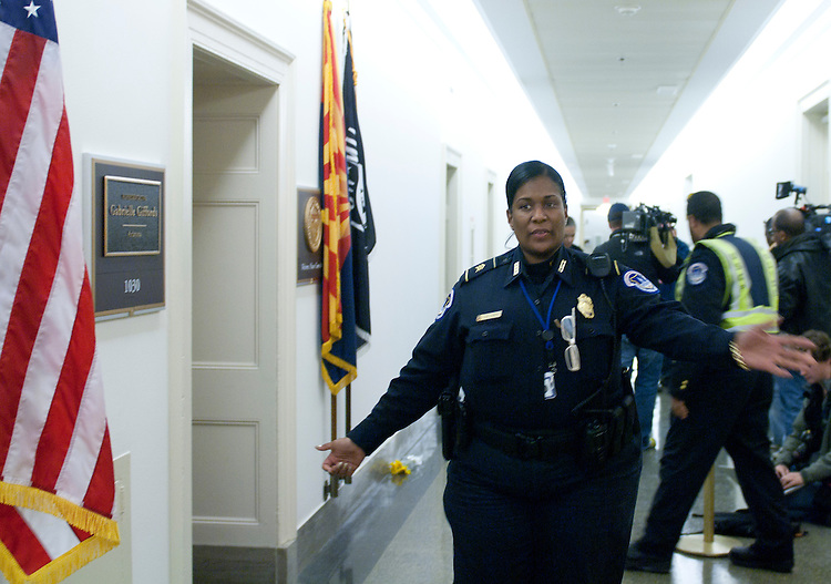 UNITED STATES - JANUARY 8: U.S. Capitol Police clear media away from Rep. Gabrielle Giffords' Capitol Hill office in the Longworth House Office Building after the congresswoman was shot in her home district in Tucson, Ariz., on Saturday, Jan. 8, 2011.  (Photo By Bill Clark/Roll Call)