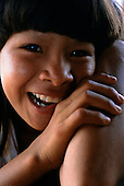 Ipixuna village, Amazon, Brazil. Young Arawete girl, laughing.