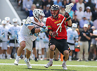 Baltimore, MD - April 28, 2018: Maryland Terrapins Tim Rotanz (7) gets pushed by a Johns Hopkins Blue Jays defender during game between John Hopkins and Maryland at  Homewood Field in Baltimore, MD.  (Photo by Elliott Brown/Media Images International)