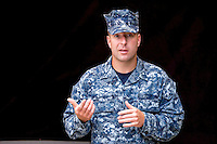Sailor in NWU Blue Uniform, model-released, talking to camera Stock photograph by Hans Halberstadt.  Reproduction requires written permission from Hans Halberstadt, Military Stock Photography, or designated representative