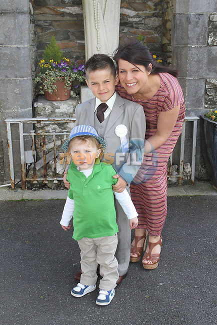James Younger Hobbs  with Clara and Euan at Callystown NS Communion in Clogherhead Church...(Photo Jenny Matthews/www.golffile.ie)