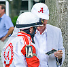 owner Joe Gillis shows jockey Gary Wales a picture before The Delaware Park Arabian Oaks (grade II) at Delaware Park on 8/6/16