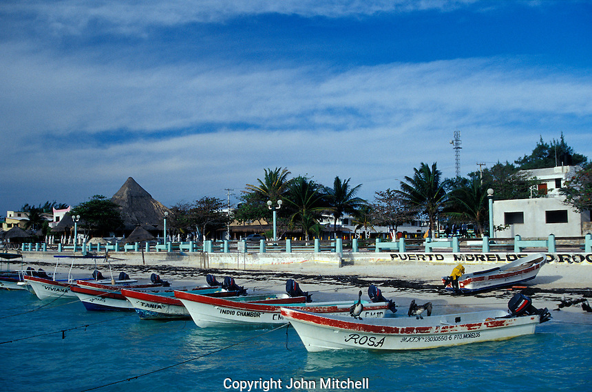 Fishing boats and waterfornt in Puerto Morelos, Quintana Roo, Mexico