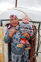 Mongolia, Bayan-Ulgii, Ulgii, Altai Mountains near Tsambagarav Mountain. Woman with baby.