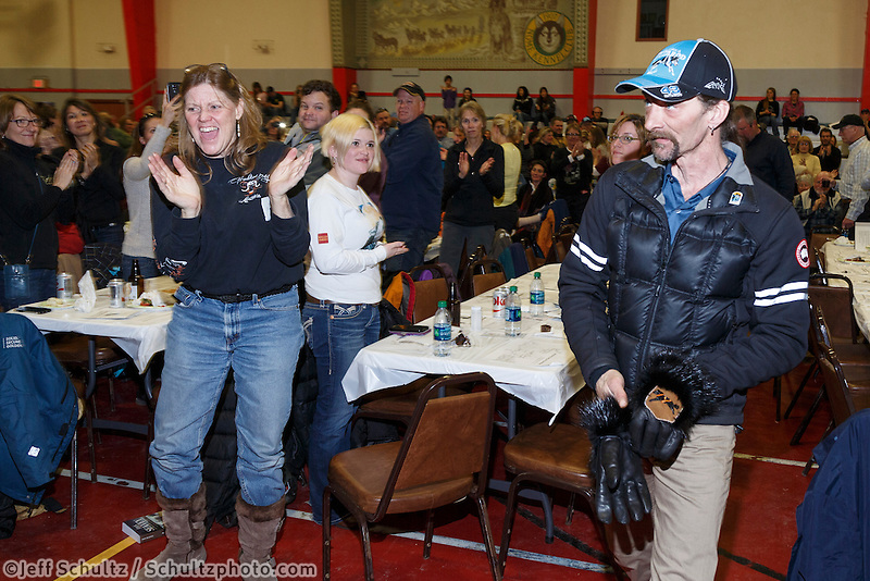 Lance Mackey gets a standing ovation from the crowd as he's announced as the Donlin Gold sportsmanship award winner at the finishers banquet in Nome on Sunday  March 22, 2015 during Iditarod 2015.  <br /> <br /> (C) Jeff Schultz/SchultzPhoto.com - ALL RIGHTS RESERVED<br />  DUPLICATION  PROHIBITED  WITHOUT  PERMISSION