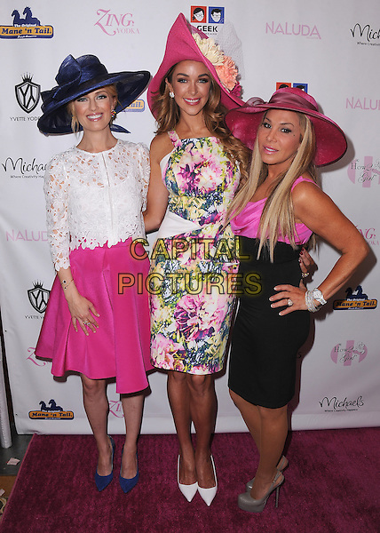 WESTLAKE VILLAGE, CA - MAY 3:   Brooke Anderson, Courtney Bingham and Adrienne Maloof at the How2Girl Kentucky Derby Ladies Luncheon at the Four Seasons Westlake Village on May 3, 2014 in Westlake Village, California.   <br /> CAP/MPI/PGSK<br /> &copy;PGSK/MediaPunch/Capital Pictures