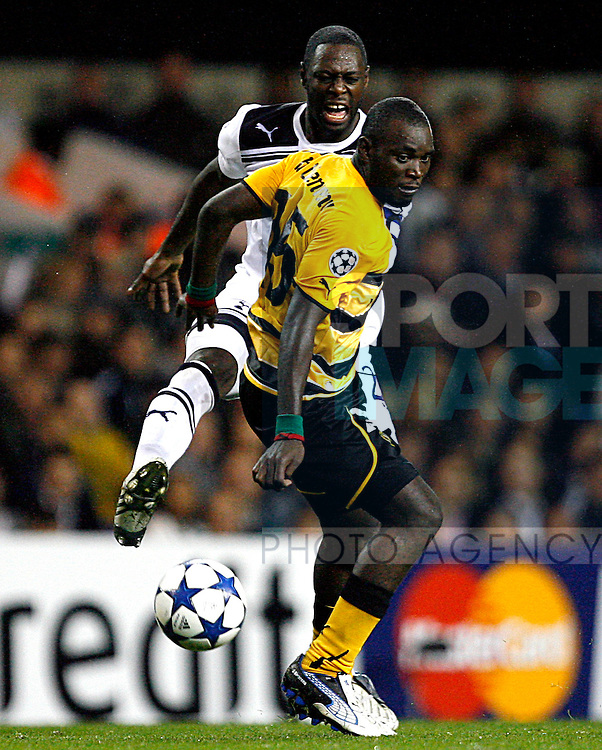 Henri Bienvenu Ntsama of Young Boys holds off Ledley King of Tottenham Hotspur