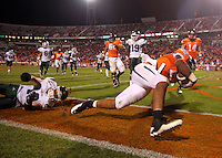 Oct 23, 2010; Charlottesville, VA, USA;  Virginia Cavaliers running back Keith Payne (22) slips into the endzone for a touchdown in front of Eastern Michigan Eagles cornerback Ryan Downard (10) during the 2nd half of the game at Scott Stadium. Virginia won 48-21. Mandatory Credit: Andrew Shurtleff