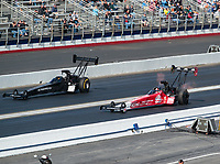 Feb 9, 2019; Pomona, CA, USA; NHRA top fuel driver Mike Salinas (left) races alongside Doug Kalitta during qualifying for the Winternationals at Auto Club Raceway at Pomona. Mandatory Credit: Mark J. Rebilas-USA TODAY Sports