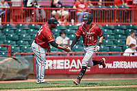 Altoona Curve coach Salvador Paniagua (54) congratulates Jared Oliva (41) as he rounds the bases after hitting a home run during an Eastern League game against the Erie SeaWolves and on June 4, 2019 at UPMC Park in Erie, Pennsylvania.  Altoona defeated Erie 3-0.  (Mike Janes/Four Seam Images)