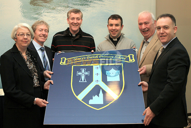 Former Principal of Fatima, Ann Barden, Present Principal of Fatima Phillip Ward, Fr. Denis Nulty, Fr. Joe Campbell, Former Principal of St.Mary's Congress Avenue Peter Darcy and Present Principal of St.Mary's John Weir with the New School Crest at the Fundraiser for the New St.Mary's Parish Primary School  in the d Hotel...(Photo credit should read Jenny Matthews www.newsfile.ie)....This Picture has been sent you under the conditions enclosed by:.Newsfile Ltd..The Studio,.Millmount Abbey,.Drogheda,.Co Meath..Ireland..Tel: +353(0)41-9871240.Fax: +353(0)41-9871260.GSM: +353(0)86-2500958.email: pictures@newsfile.ie.www.newsfile.ie.