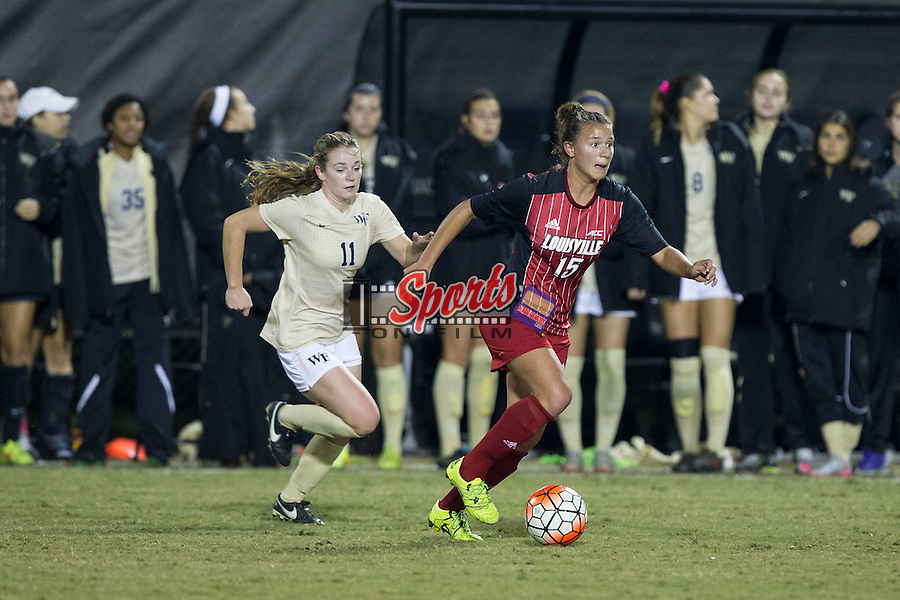 Jill Vetere (15) of the Louisville Cardinals keeps the ball away from Maddie Huster (11) of the Wake Forest Demon Deacons during second half action at Spry Soccer Stadium on October 31, 2015 in Winston-Salem, North Carolina.  The Demon Deacons defeated the Cardinals 2-1.  (Brian Westerholt/Sports On Film)