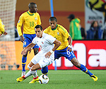 Michel Bastos defends during the 2010 FIFA World Cup South Africa Round of Sixteen match between Brazil and Chile at Ellis Park Stadium on June 28, 2010 in Johannesburg, South Africa.