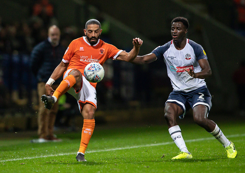 Bolton Wanderers' Josh Emmanuel competing with Blackpool's Liam Feeney (left) <br /> <br /> Photographer Andrew Kearns/CameraSport<br /> <br /> The EFL Sky Bet League One - Bolton Wanderers v Blackpool - Monday 7th October 2019 - University of Bolton Stadium - Bolton<br /> <br /> World Copyright © 2019 CameraSport. All rights reserved. 43 Linden Ave. Countesthorpe. Leicester. England. LE8 5PG - Tel: +44 (0) 116 277 4147 - admin@camerasport.com - www.camerasport.com