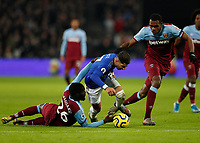 28th December 2019; London Stadium, London, England; English Premier League Football, West Ham United versus Leicester City; Ayoze Perez of Leicester City being challenged by Arthur Masuaku of West Ham United  - Strictly Editorial Use Only. No use with unauthorized audio, video, data, fixture lists, club/league logos or 'live' services. Online in-match use limited to 120 images, no video emulation. No use in betting, games or single club/league/player publications
