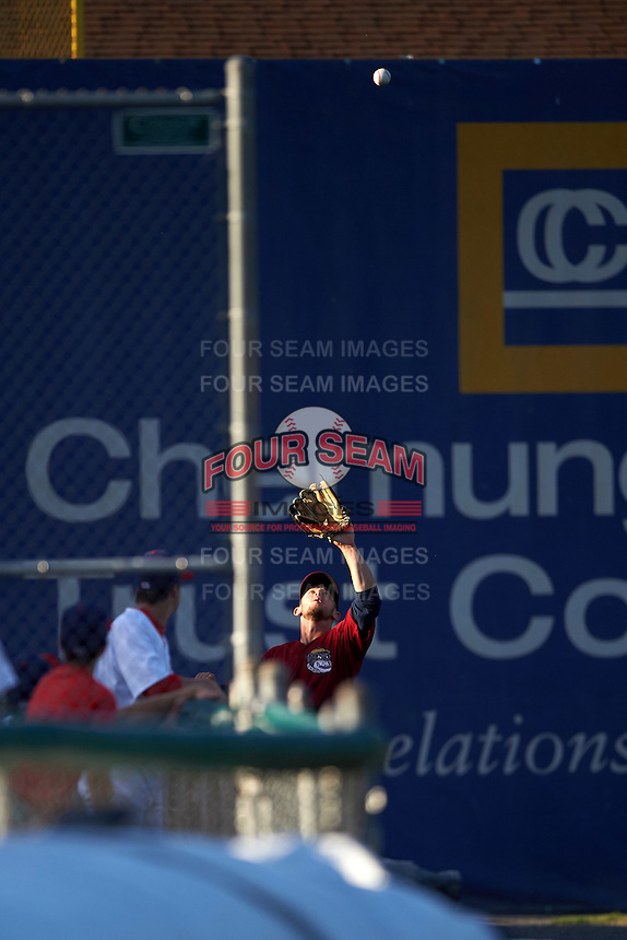 Mahoning Valley Scrappers left fielder Andrew Calica (26) tracks down a fly ball during a game against the Auburn Doubledays on July 17, 2016 at Falcon Park in Auburn, New York.  Mahoning Valley defeated Auburn 3-2.  (Mike Janes/Four Seam Images)