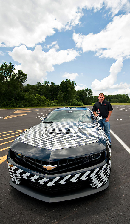 NASCAR Team Chevrolet driver Ryan Newman - who has an Engineering degree from Purdue University - stands with a Chevy Camaro ZL1 development vehicle after a test drive at the General Motors Milford Proving Ground Thursday, June 16, 2011 in Milford, Michigan. Newman spent the afternoon talking to engineers during a tour of the engineering and vehicle development areas the facility. Newman hopes to win his third NASCAR Sprint Cup race at Michigan International Speedway in Brooklyn, Michigan on Sunday in his U.S. Army/Bud Moore Chevy for Stewart-Haas Racing. (Photo by Steve Fecht for Chevrolet Racing)