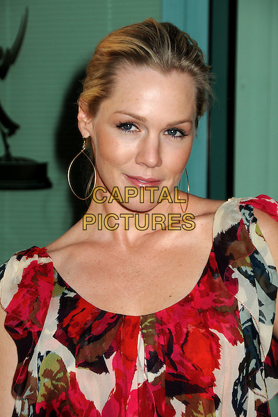 "JENNIE GARTH .Attending An Evening with ""Nurse Jackie"" Presented by the Academy of Television Arts & Sciences held at the Leonard H. Goldenson Theatre, North Hollywood, California, USA, .15th March 2010..portrait headshot red floral print black flower white green rose hair up earrings silver  .CAP/ADM/BP.©Byron Purvis/Admedia/Capital Pictures"