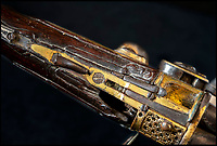 BNPS.co.uk (01202) 558833<br /> Pic: PhilYeomans/BNPS<br /> <br /> The trigger and stock have been badly damaged by a musket ball - possibly leading to Tipu Sultan's demise.<br /> <br /> Stunning artefacts from Indian hero Tipu Sultan's fateful last stand have been rediscovered by the family of an East India Company Major who took part in the famous battle that ended his reign.<br /> <br /> And now Major Thomas Hart's lucky descendents are likely to become overnight millionaires after retrieving the historic items from their dusty attic.<br /> <br /> The fascinating treasures were taken from Tipu's captured fortress of Seringapatam in the wake of his defeat by British forces led by a young Duke of Wellington in 1799.<br /> <br /> The cache of ornate gold arms and personal effects even include's the battle damaged musket the Sultan used in his fatal last stand against the expanding British Empire in India.<br /> <br /> Tipu was last seen on the battlements of the fortress firing his hunting musket at the advancing British and after the fierce encounter his body was found bearing many wounds, including a musket ball shot above his right eye.<br /> <br /> The rediscovered musket, complete with battle damaged bayonet, has the distinctive tiger stripe pattern unique to the self styled Tiger of Mysore own weapons - and tellingly there is also shot damage to the lock and stock that may have been caused by the musket ball that finished him off.<br /> <br /> Also included in the sale are four ornate gold-encrusted sword's bearing the mark of Haider Ali Khan, Tipu's father and the previous ruler of independent Mysore, along with a solid gold &lsquo;betel casket&rsquo; complete with three 220 year old nuts still inside.<br /> <br /> The war booty was brought back to Britain by Major Thomas Hart of the British East India Company following the fourth and final Anglo-Mysore war.<br /> <br /> They have been passed down through the family ever since and now belong to a couple who have kept them wrapped in newspaper in the dusty attic of their semi-detached home for years.