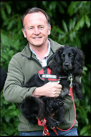 BNPS.co.uk (01202 558833)<br /> Pic: ColinButcher/BNPS<br /> <br /> Colin Butcher with his cocker spaniel Molly who was bitten on a job.<br /> <br /> The world's only cat detection dog was almost killed by a deadly snake bite while searching for a lost feline.<br /> <br /> Cocker spaniel Molly was on the trail of the missing cat with her owner Colin Butcher, a pet detective, when she was 'ambushed' by an adder.<br /> <br /> The serpent - the only venomous snake native to Britain - leapt towards Molly and sunk her fangs into her chest as the terrified dog tried to shake it off.<br /> <br /> Mr Butcher rushed to Molly to a vets where she was placed in intensive care for 48 hours.