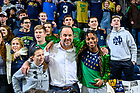 February 1, 2020; Men's Basketball head coach Mike Brey stands with the student section for the singing of the Alma Mater following a win at Purcell Pavilion. (Photo by Matt Cashore)