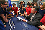 Nevada Gov. Brian Sandoval talks with a group of Carson City fifth-graders after signing into law an emergency bill extending bonds for school construction at a brief ceremony in Carson City, Nev., on Wednesday, March 4, 2015. More than a dozen lawmakers joined Sandoval for the signing of the bill which had bipartisan support in both houses.<br /> Photo by Cathleen Allison