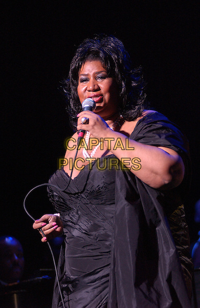 "ARETHA FRANKLIN.The ""Queen of Soul"" performs at the 10th Annual American Music Masters held at the State Theatre, Playhouse Square..USA, United States .5th November 2005.Ref: ADM/JN.half length performing singing on stage gig live show microphone.www.capitalpictures.com.sales@capitalpictures.com.© Capital Pictures."