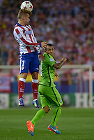 MADRID - ESPAÑA - 01-10-2014: Antoine Griezmann (Izq.) jugador de Atletico de Madrid de España, disputa el balon Carlos Tévez (Der.) jugadores de Juventus de Italia durante partido del la UEFA Liga de Campeones, Atletico de Madrid  y Juventus en el estadio Vicente Calderon de la ciudad de Madrid, España. / Antoine Griezmann (L) player of Atletico de Madrid of Spain vies for the ball with Carlos Tévez (R) players of Juventus of Italy, during a match between Atletico de Madrid and Juventus for the UEFA Champions League in the Vicente Calderon stadium in Madrid, Spain  Photo: Asnerp / Patricio Realpe / VizzorImage.