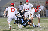 College Park, MD - April 29, 2017: Johns Hopkins Blue Jays Cody Radziewicz (2) is hit by several Maryland Terrapins defenders during game between John Hopkins and Maryland at  Capital One Field at Maryland Stadium in College Park, MD.  (Photo by Elliott Brown/Media Images International)