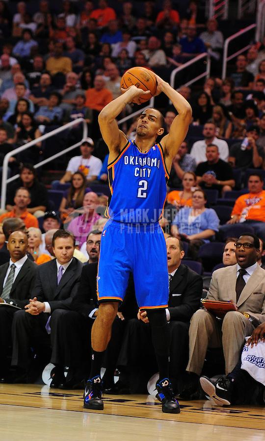 Mar. 30, 2011; Phoenix, AZ, USA; Oklahoma City Thunder guard (2) Thabo Sefolosha against the Phoenix Suns at the US Airways Center. Mandatory Credit: Mark J. Rebilas-